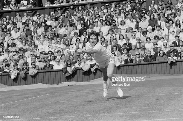 American tennis player Jimmy Connors competing against number 7 seed Bob Hewitt of South Africa in the first round of the Men's Singles at Wimbledon...