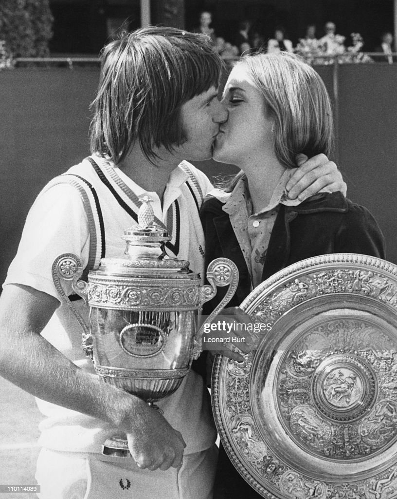 American tennis player <a gi-track='captionPersonalityLinkClicked' href=/galleries/search?phrase=Jimmy+Connors&family=editorial&specificpeople=157507 ng-click='$event.stopPropagation()'>Jimmy Connors</a> kisses his fiancee <a gi-track='captionPersonalityLinkClicked' href=/galleries/search?phrase=Chris+Evert+-+Tennis+Player&family=editorial&specificpeople=206410 ng-click='$event.stopPropagation()'>Chris Evert</a> after winning the men's singles final at Wimbledon, London, 6th July 1974. Evert had just won the women's singles.