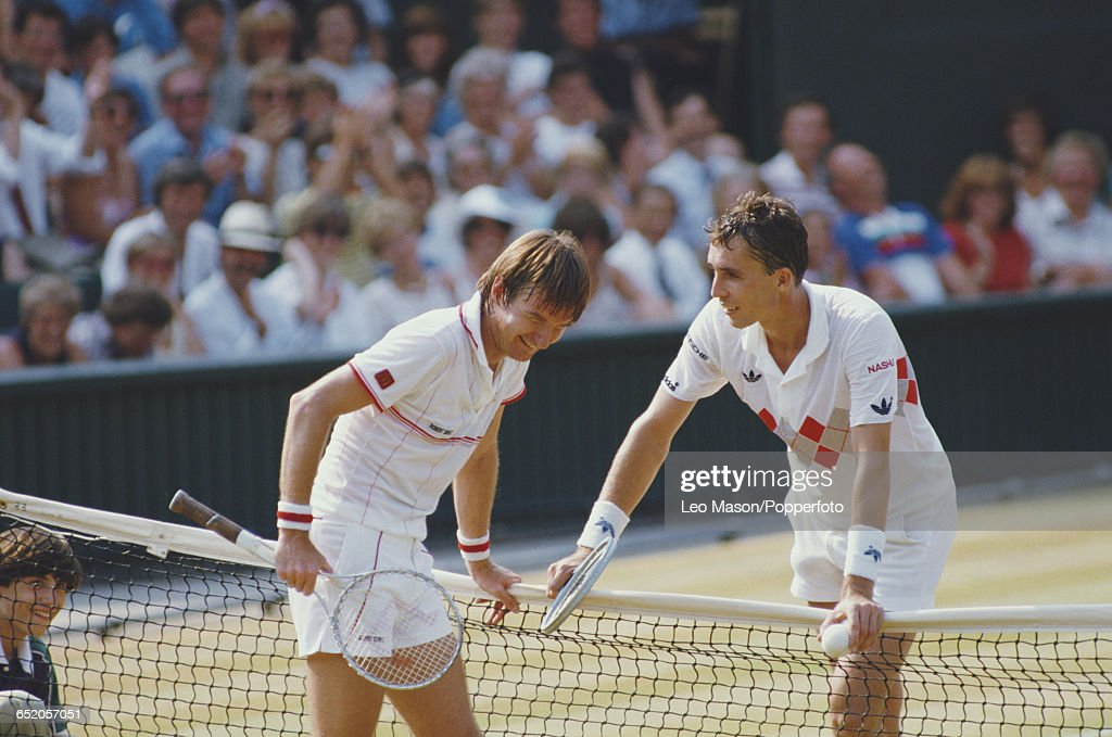 American tennis player Jimmy Connors pictured left at the net with Czechoslovak tennis player Ivan Lendl during their semifinal match of the Men's...