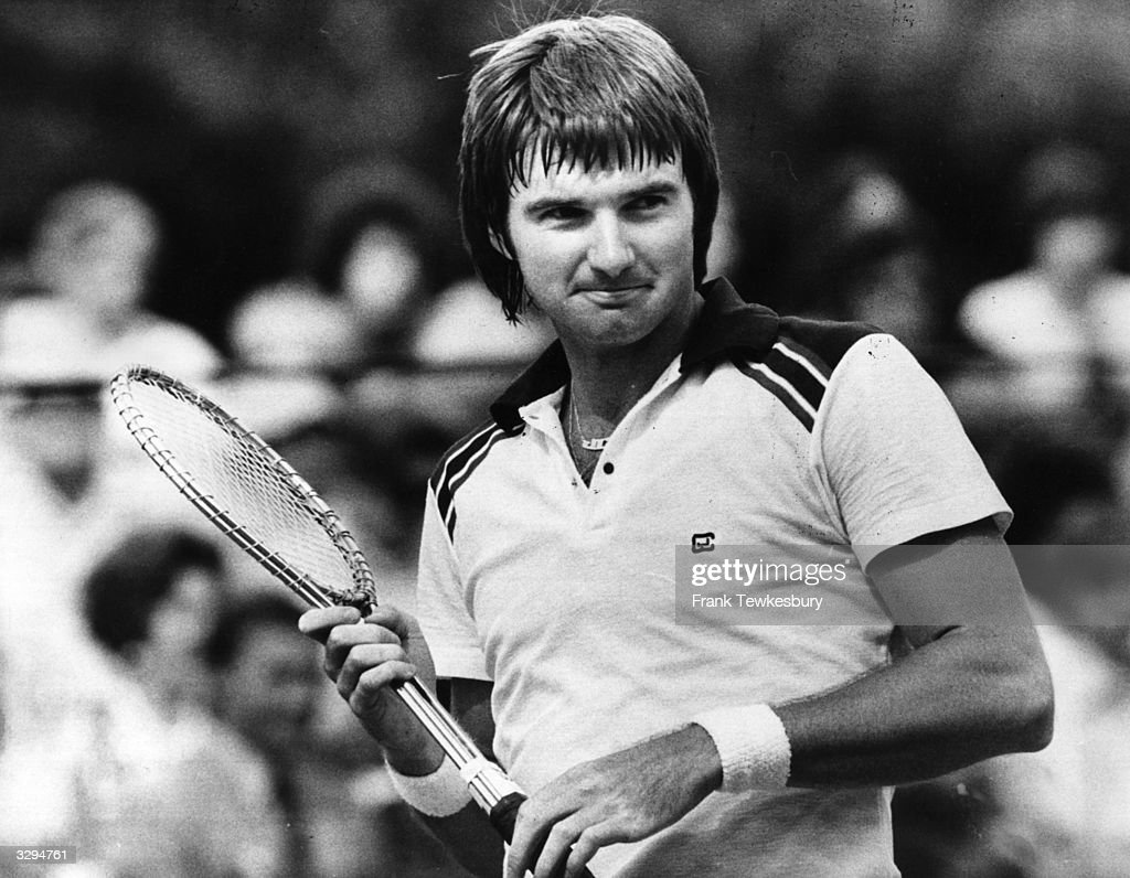 American tennis player Jimmy Connors pulling a cheeky face.