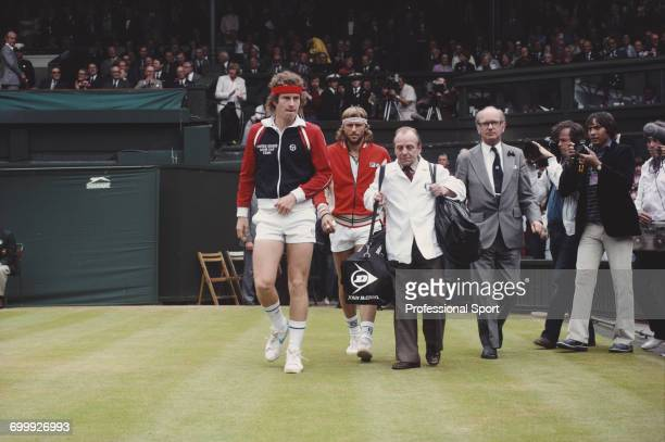 American tennis player John McEnroe and Swedish tennis player Bjorn Bjorg walk out on to Centre Court prior to play in the final of the Men's Singles...