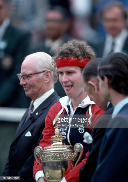 John McEnroe of the USA holding the trophy after defeating Bjorn Borg of Sweden to win the Wimbledon Lawn Tennis Championships at the All England...