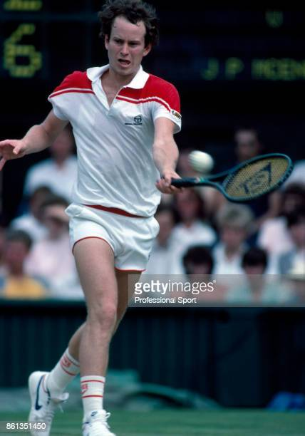 John McEnroe of the USA in action against Chris Lewis of New Zealand during the mens singles Final match at the Wimbledon Lawn Tennis Championships...