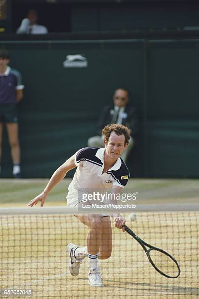 American tennis player John McEnroe pictured in action competing against Jimmy Connors in the final of the Men's Singles tournament at the Wimbledon...