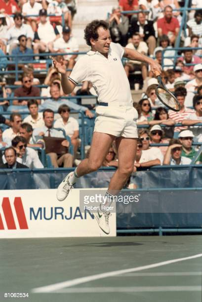 American tennis player John McEnroe in midst of a match mid 1980s