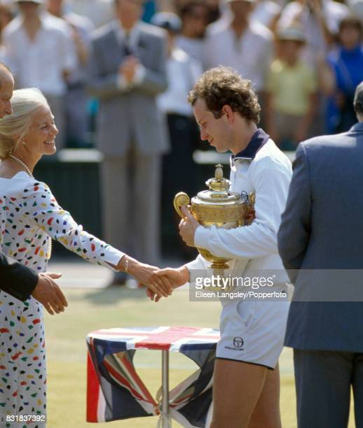 John McEnroe of the USA is presented with the trophy by the Duchess of Kent after his victory in the men's singles final during the Wimbledon Lawn...