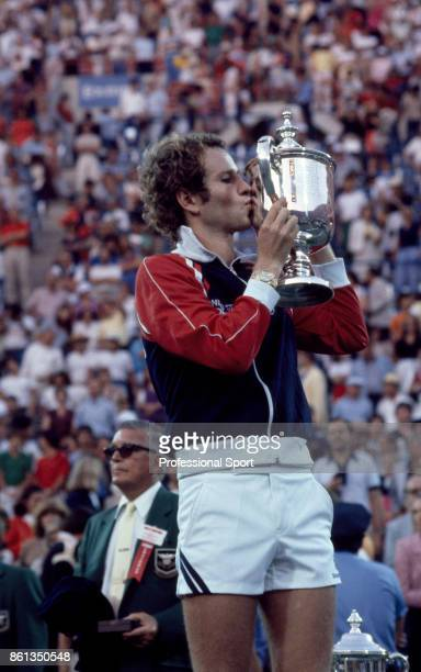 John McEnroe of the USA kisses the trophy after defeating Bjorn Borg of Sweden to win the US Open at the USTA National Tennis Center on September 13...