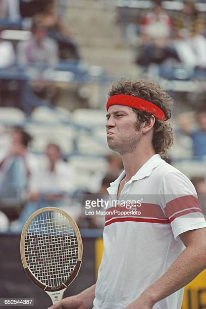 American tennis player John McEnroe pictured grimacing during competition to progress to win the final of the 1980 US Open Men's Singles tennis...