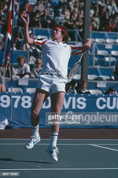 American tennis player John McEnroe pictured in action competing for the United States team to win against the Great Britain team during the final of...