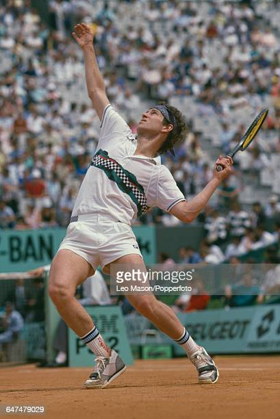 American tennis player John McEnroe pictured in action competing to be knocked out by Horacio de la Pena in the first round of the Men's Singles...