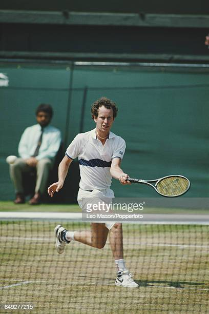 American tennis player John McEnroe pictured in action competing to reach the quarterfinals of the Men's Singles tournament at the Wimbledon Lawn...