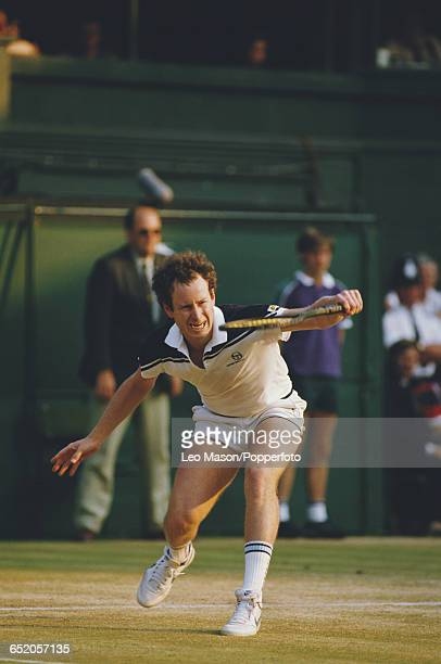 American tennis player John McEnroe pictured in action competing to progress to win the final of the Men's Singles tournament at the Wimbledon Lawn...