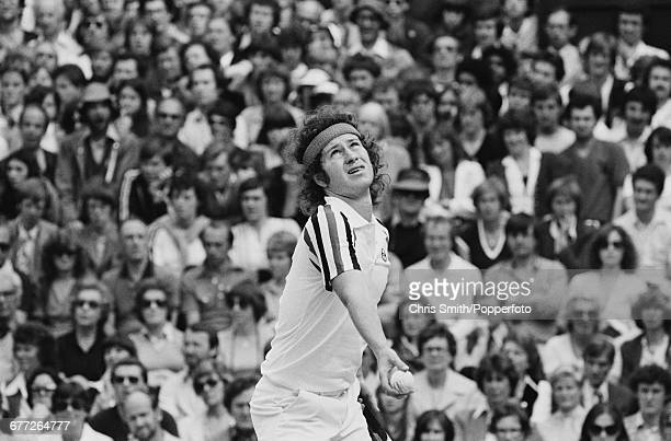 American tennis player John McEnroe pictured in action competing to lose the final of the Men's Singles tournament to Swedish tennis player Bjorn...