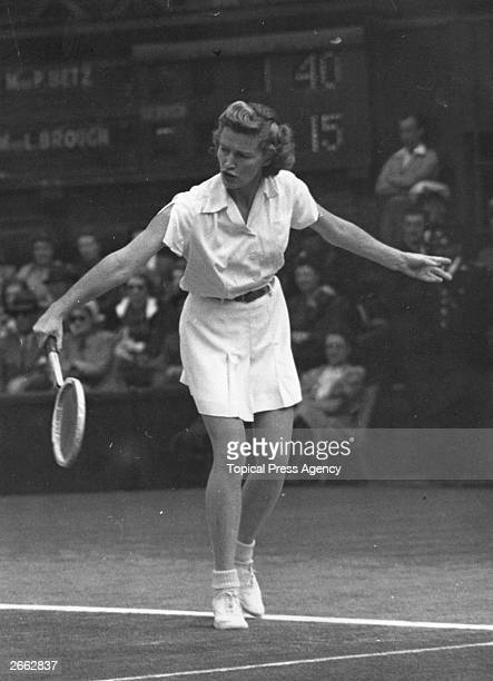 American tennis player Pauline Getz in action against Louise Brough in the final of the women's singles at the lawn tennis championships Wimbledon...