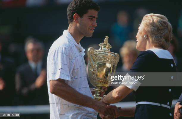 American tennis player Pete Sampras holds the Gentlemen's Singles Trophy as he shakes hands with Katharine Duchess of Kent after defeating German...