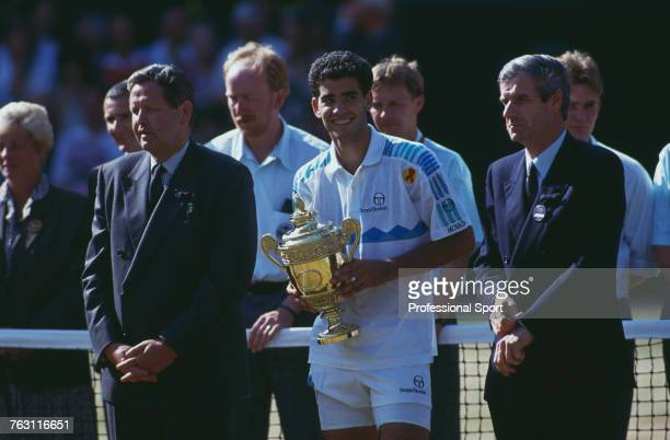 American tennis player Pete Sampras holds the Gentlemen's Singles Trophy after beating fellow American Jim Courier 76 76 36 63 to win the final of...