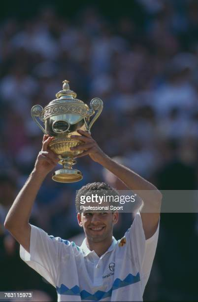 American tennis player Pete Sampras holds up the Gentlemen's Singles Trophy after beating fellow American Jim Courier 76 76 36 63 to win the final of...