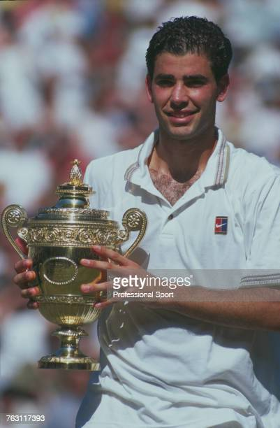 American tennis player Pete Sampras holds up the Gentlemen's Singles Trophy after beating Croatian tennis player Goran Ivanisevic 76 76 60 to win the...