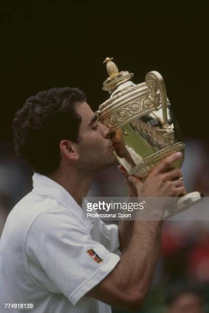 American tennis player Pete Sampras kisses the Gentlemen's Singles trophy after beating Croatian tennis player Goran Ivanisevic 67 76 64 36 62 in the...