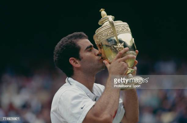 American tennis player Pete Sampras kisses the Gentlemen's Singles trophy after beating fellow American Andre Agassi 63 64 75 in the final of the...
