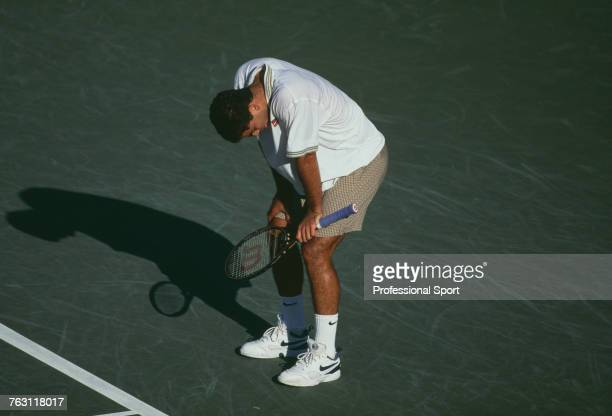 American tennis player Pete Sampras looks down in disappointment after being defeated by Peruvian tennis player Jaime Yzaga in the 4th round of the...