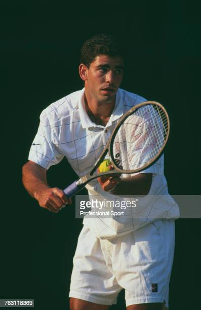 American tennis player Pete Sampras pictured in action competing to progress to win the final of the Men's Singles tournament at the Wimbledon Lawn...