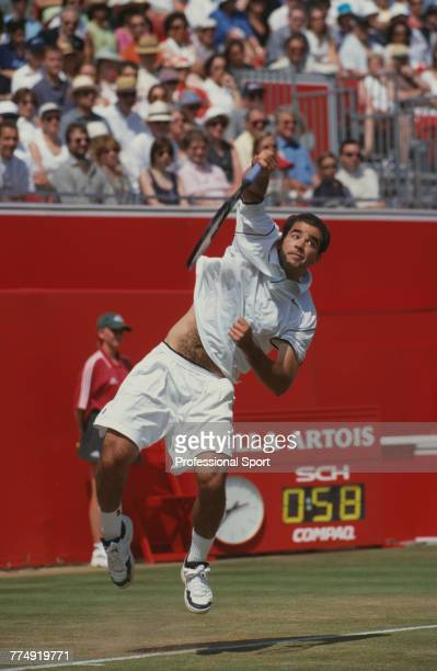 American tennis player Pete Sampras pictured in action during competition to reach the final of the 2000 Stella Artois Championships singles...