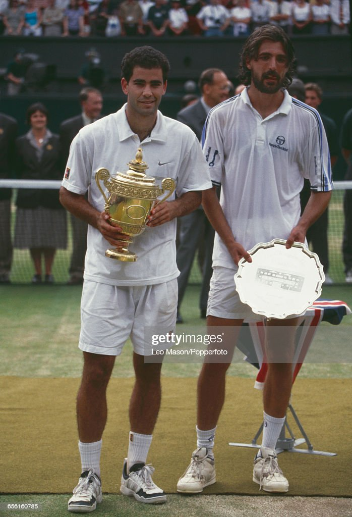 American tennis player Pete Sampras pictured left holding the Gentlemen's Singles Trophy with defeated Croatian tennis player Goran Ivanisevic on...