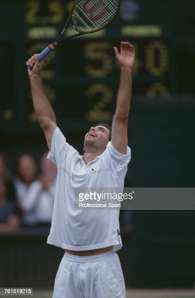 American tennis player Pete Sampras raises his arms in the air in celebration after beating Goran Ivanisevic of Croatia to win the final of the Men's...