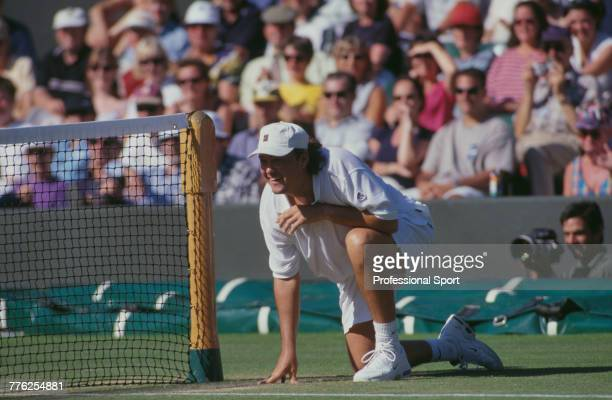 American tennis player Robert Seguso pictured in action crouching at the net during competition in the Men's Seniors tennis tournament at the...