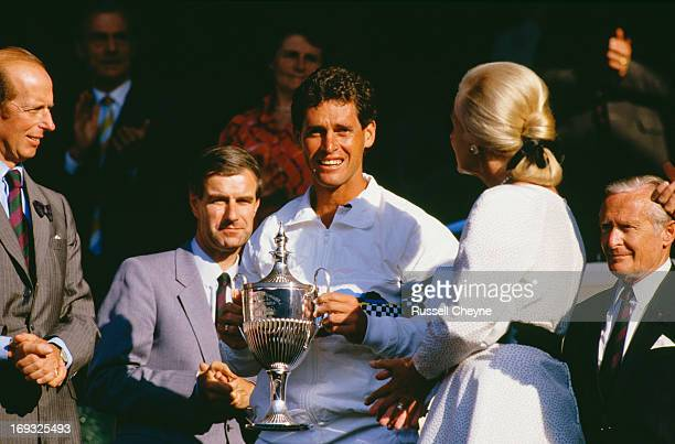 American tennis player Tim Gullikson receives a trophy from Katharine Duchess of Kent and Prince Edward Duke of Kent at Wimbledon London 1987
