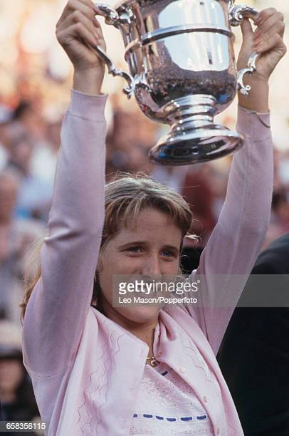 American tennis player Tracy Austin holds up the US OpenTrophy as champion after defeating Chris Evert 64 63 in the final of the 1979 US Open Women's...