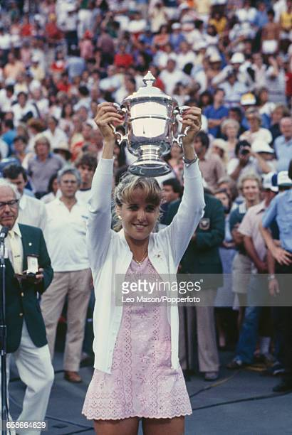 American tennis player Tracy Austin holds up the US OpenTrophy as champion after defeating Martina Navratilova 16 76 76 in the final of the 1981 US...