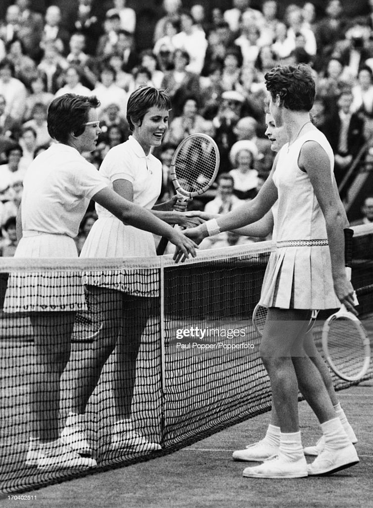 American tennis players <a gi-track='captionPersonalityLinkClicked' href=/galleries/search?phrase=Billie+Jean+King&family=editorial&specificpeople=93147 ng-click='$event.stopPropagation()'>Billie Jean King</a> (far left) and Karen Hantze Susman shake hands over the net with their Australian opponents Jan Lehane O'Neill (right, foreground) and <a gi-track='captionPersonalityLinkClicked' href=/galleries/search?phrase=Margaret+Court&family=editorial&specificpeople=226911 ng-click='$event.stopPropagation()'>Margaret Court</a> after the Americans won the Ladies' Doubles Final, 6-3, 6-4, at Wimbledon, London, 9th July 1961.
