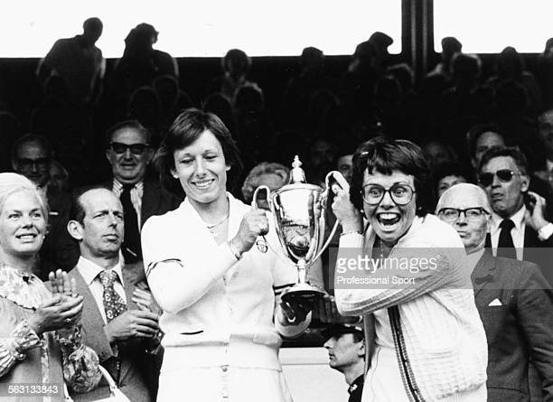 American tennis players Billie Jean King and Martina Navratilova holding their trophy in the Royal Box after winning the Women's Doubles event at...
