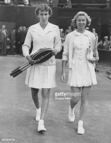 American tennis players Doris Hart and Beverly Baker Fleitz walk onto the court for the semifinal of the Women's Singles at Wimbledon London 30th...