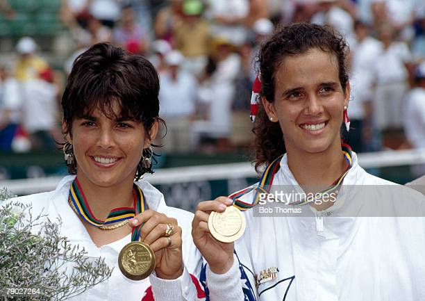 American tennis players Gigi Fernandez and Mary Joe Fernandez proudly display their gold medals after finishing first in the Women's doubles tennis...