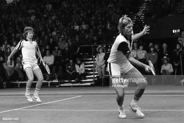 American tennis players John McEnroe and Peter Fleming in action against Ilie Nastase and Sherwood Stewart at London's Olympia where they won the...