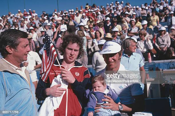 American tennis players John McEnroe and Stan Smith pictured with captain Tony Trabert as they prepare to compete for the United States team against...