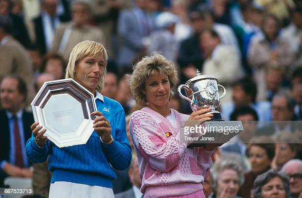 American tennis players Martina Navratilova and Chris EvertLloyd with the trophies after Evert beat Navratilova to win the Women's Singles title at...