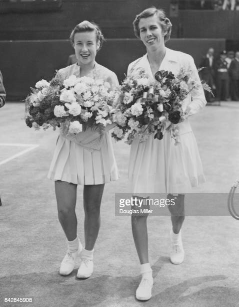 American tennis players Maureen Connolly and Doris Hart walk onto the court for the final of the Women's Singles at Wimbledon London 4th July 1953