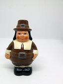 Close-up of Thanksgiving pilgrim against white background
