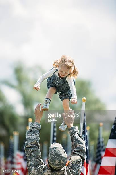 American toddler girl playing happily with her father