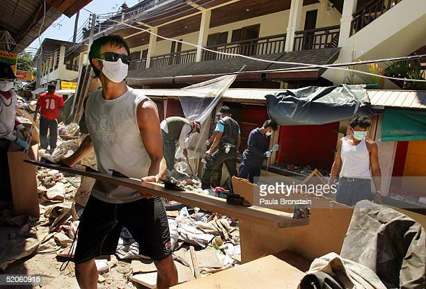 American tourist David Campbell from Los Angeles California helps clean up debris January 25 2005 almost one month after the devastating Tsunami hit...