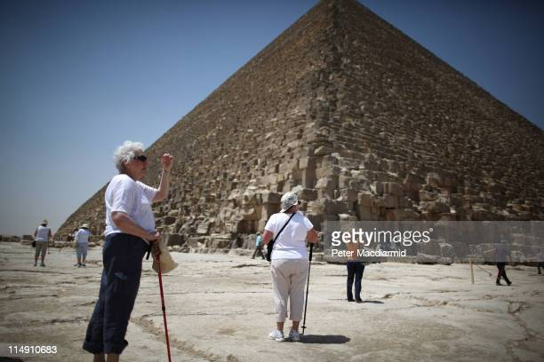 American tourists visit the Great Pyramid of Cheops on May 28 2011 in Giza Egypt Protests in January and February brought an end to 30 years of...