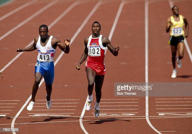 American track and field athlete Carl Lewis crosses the finish line in second place with Linford Christie of Great Britain in third place in the...