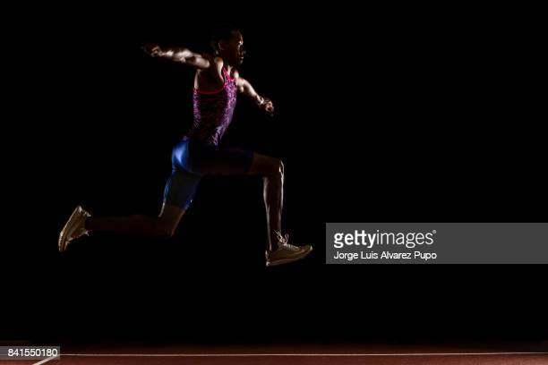 American track and field athlete Christian Taylor wearing gold trainers jumps during a photo session at Papendal Olympic Training Centre on August 30...