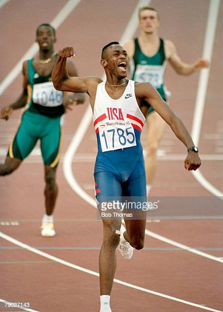 American track and field athlete Kevin Young of the United States team crosses the finish line in first place to win the gold medal in the Men's 400...