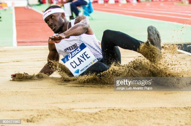 American track and field athlete Will Claye lands into the sand pit in the Triple Jump competition during Meeting de Paris of the IAAF Diamond League...