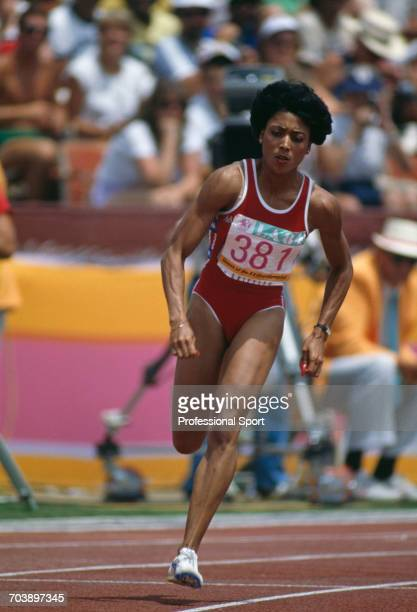 American track athlete Florence Griffith Joyner competes to finish in 2nd place in the final of the Women's 200 metres event inside the Memorial...